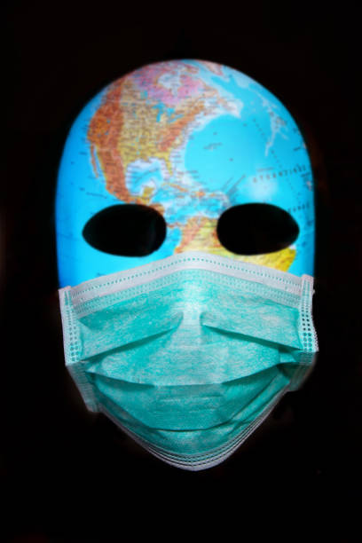 Textured mask with the map of America wearing surgical mask. Concept for corona virus pandemia. stock photo