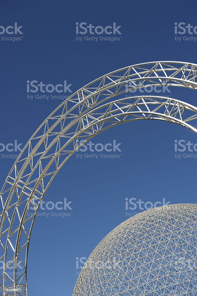 Textured Metal Globe Biosphere with Arch Blue Sky stock photo