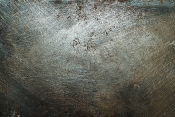 Textured metal surface with traces of corrosion stock photo