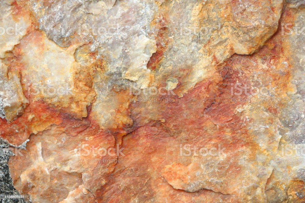 Textured Of Surface Stone Wall For Background Tone Orange