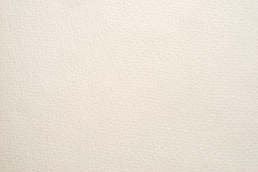 textured paper for watercolor painting. beige factured background, suitable as a backdrop for business presentation.