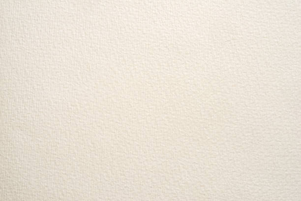 textured paper for watercolor painting. beige factured background, suitable as a backdrop for business presentation. stock photo