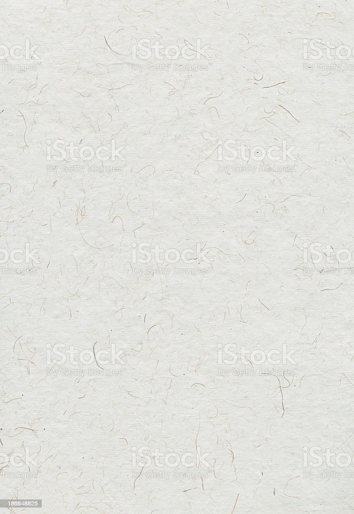 Textured paper with darker fibres visible stock photo