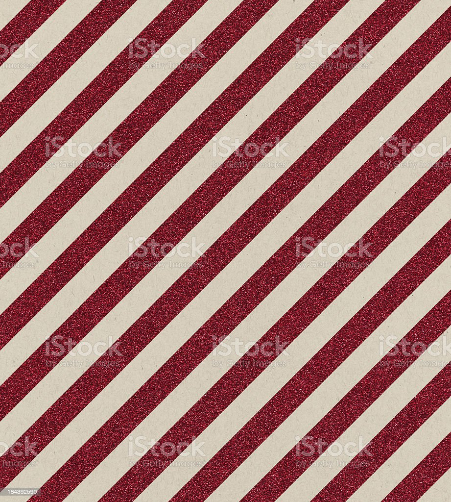 textured paper with red glitter stripe stock photo
