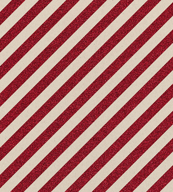 textured paper with red glitter stripe - wrapping paper stock photos and pictures