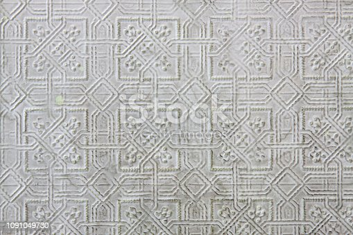Textured pattern in pressed tin with pale green imperfections