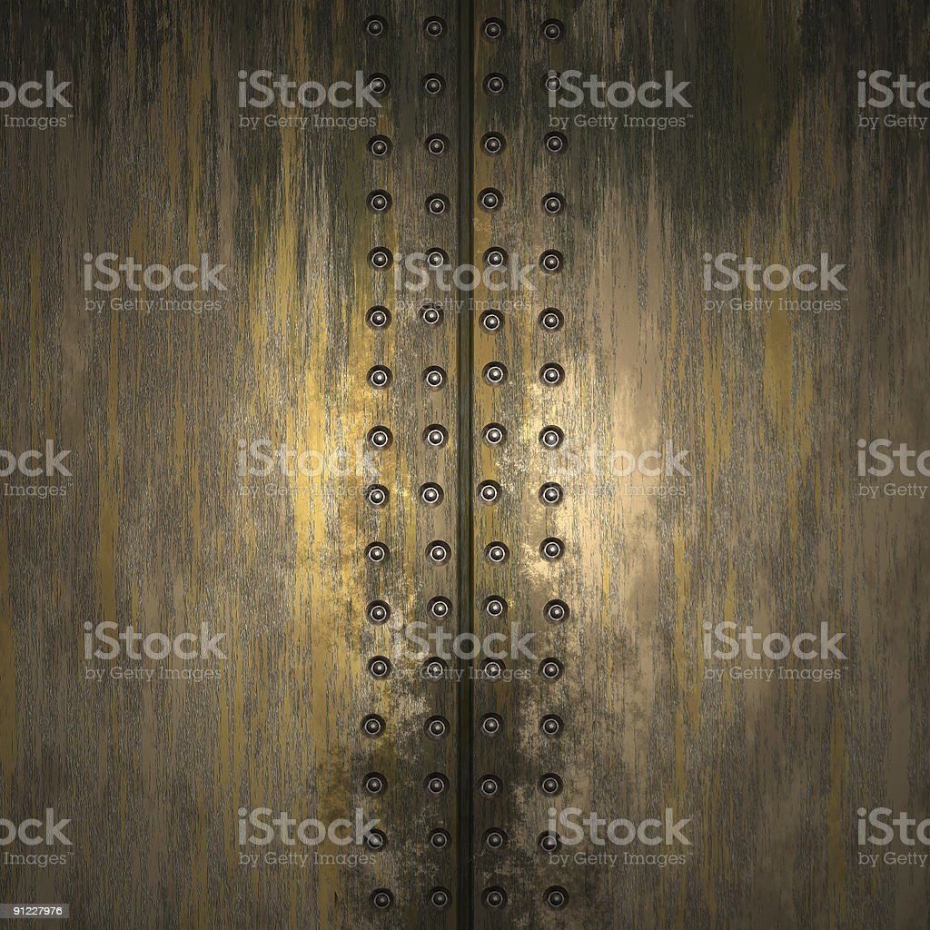 Textured rivets in pieces of metal royalty-free stock photo
