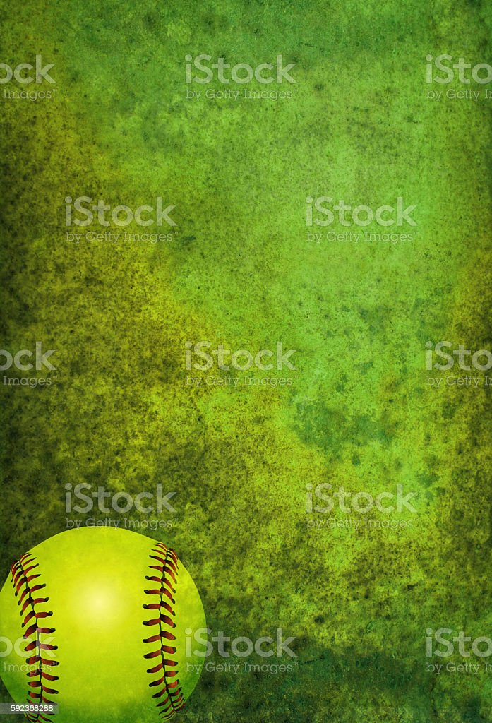 A green textured softball background with ball. Room for copy.