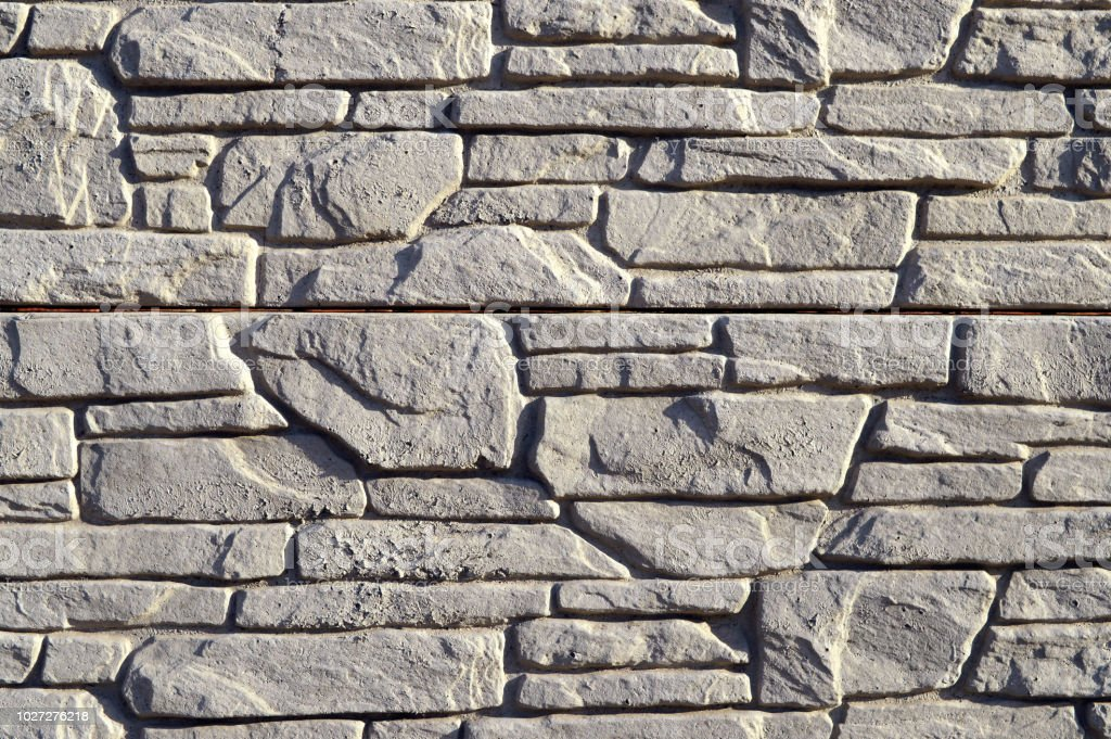 Textured stone walls built of large rough stones held together by...