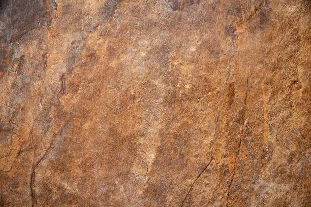 Textured surface of the marble rock with brown tint background stock photo