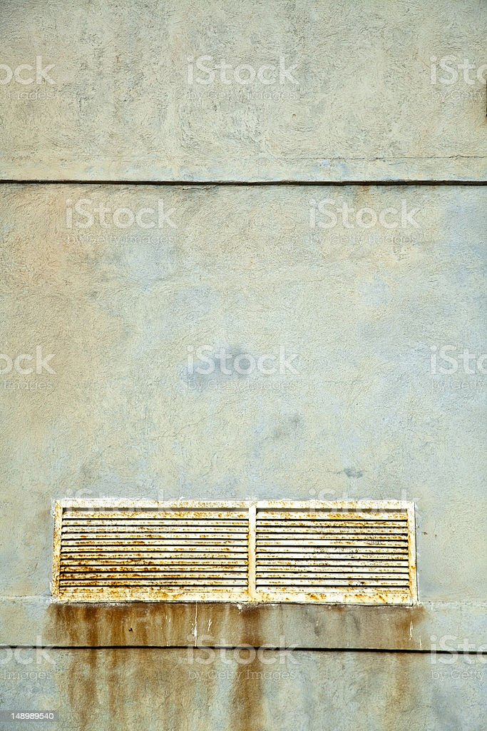 Textured Wall and Rusty Vent Shaft Cover royalty-free stock photo