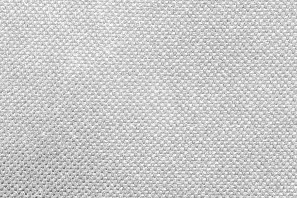 textured white fabric cloth texture with natural patterns can be used as background. closeup view - nylon texture stock pictures, royalty-free photos & images