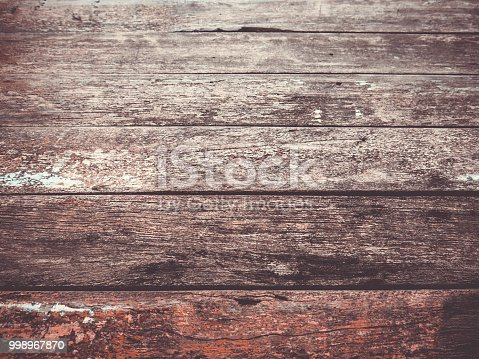 Several planks of old wood lie together.  Rustic, weathered and worn, it has a certain charm.