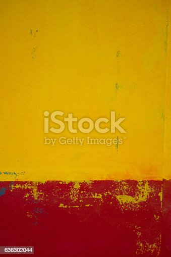 A rendered wall painted yellow and red which would make an excellent textured background.