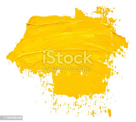 Textured yellow oil paint brush stroke, isolated on white background
