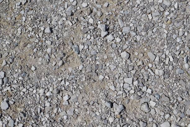 texturen van grind keien en stenen - grind stockfoto's en -beelden
