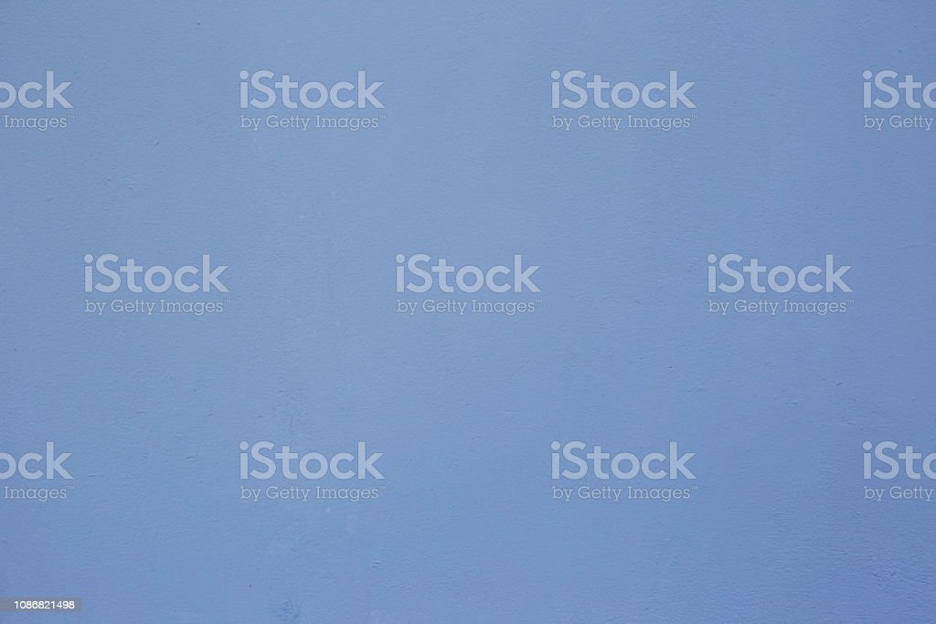 Textures on the blue wall, for background. Plastered concrete wall, painted in blue, surface texture. stock photo
