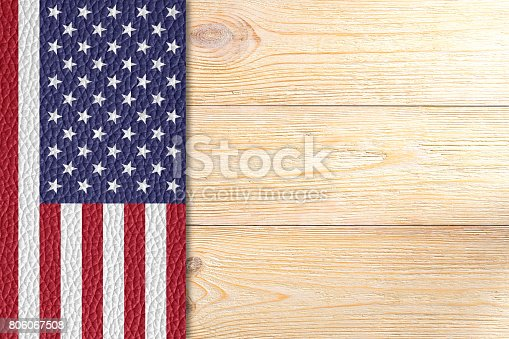 istock texured united states flag over wooden planks 806067508
