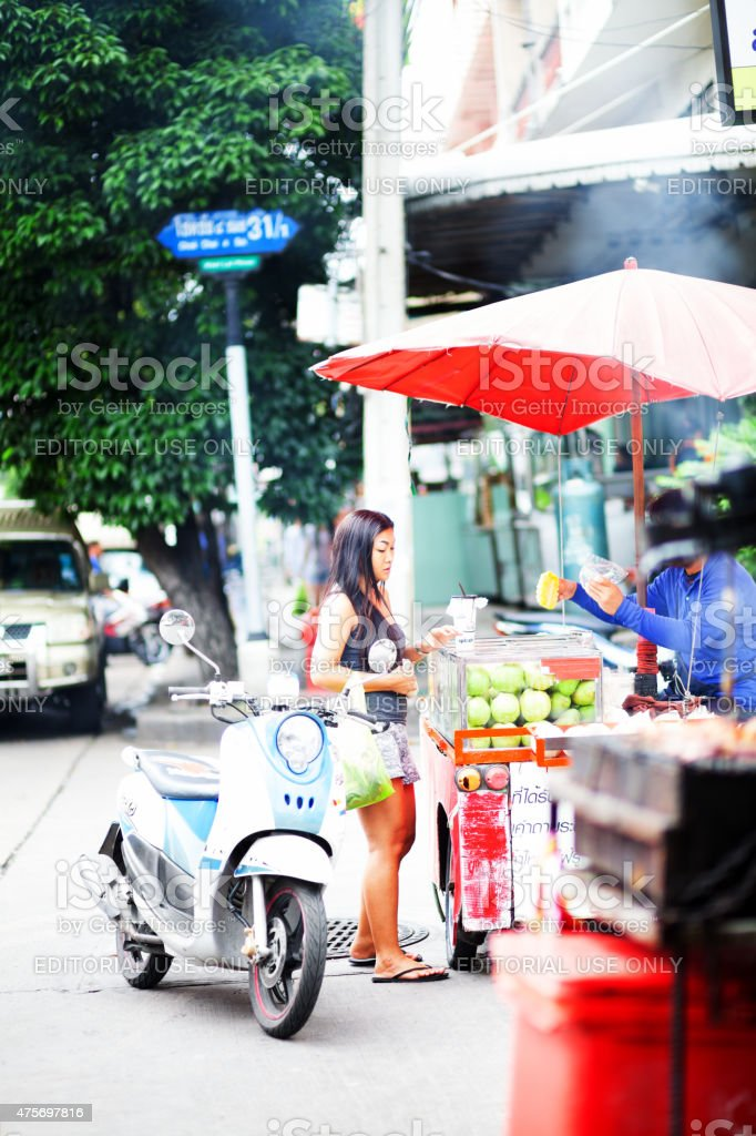Thai adult woman buying fruits stock photo