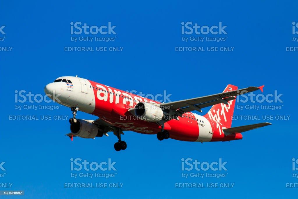 thai airasia airplane landing at chiangmai international airport in rh istockphoto com