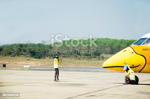 istock Thai aircraft marshaller marshalling and visual signal between ground personnel and pilots 682866036