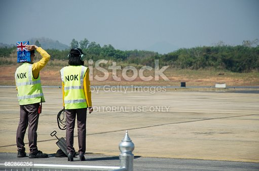istock Thai aircraft marshaller marshalling and visual signal between ground personnel and pilots 682866256