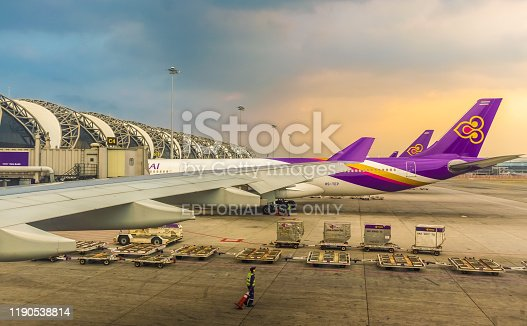 istock Thai Airways Boeing Park the passenger terminal at Suvarnabhumi Airport. 1190538814