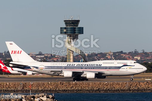 Sydney, Australia - October 9, 2013: Thai Airways International Boeing 747 jumbo jet HS-TGP in retro Thai Airways Livery taxis for departure from Sydney Airport.