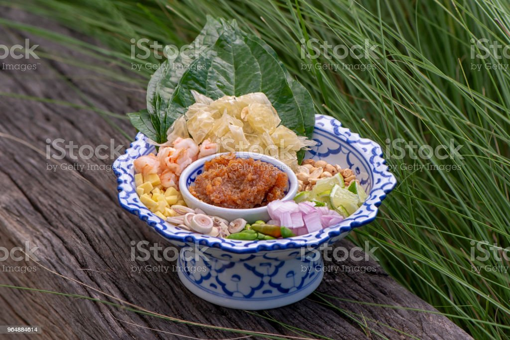 Thai appetizer leaf wrapped with herbs (Miang Kham) royalty-free stock photo