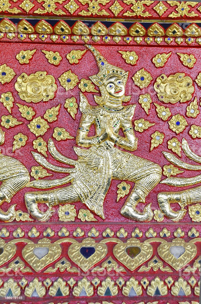 Thai art on the wall designed at  temple royalty-free stock photo