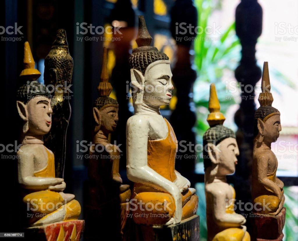 Thai Art : Profile of Ancient Wood Buddha Statues stock photo