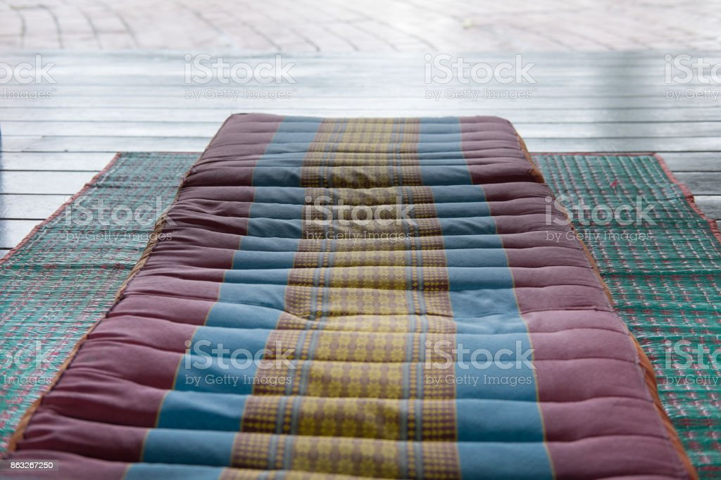 Thai backrest pillow on mat. Thailand scatter cushion mattress for spa massage. comfortable & relax concept stock photo