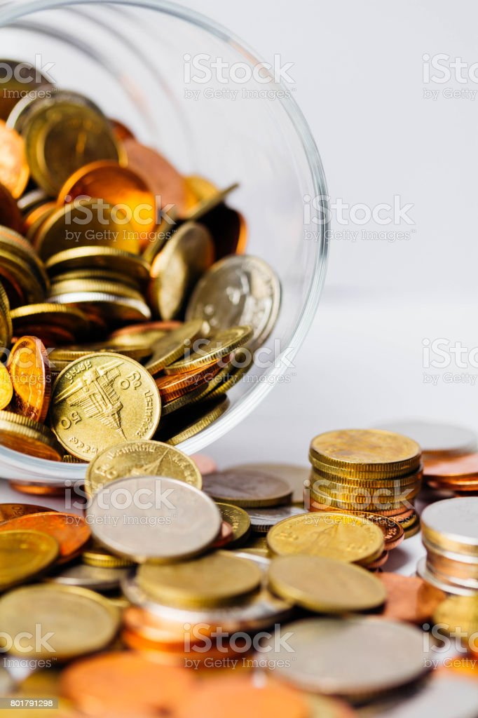 Thai Baht Coins money in glass bottles stock photo
