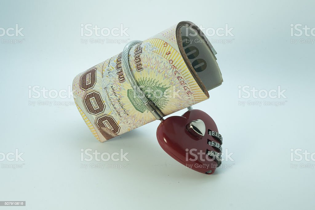 Thai baht currency notes with lock and chain. stock photo