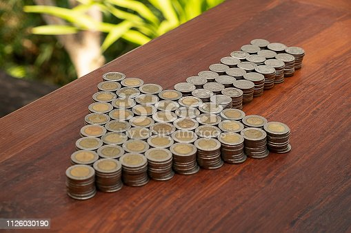 istock Thai Baht lots coin Arranged in arrow shape on with blurred background texture, Money stack for business planning investment and saving concept 1126030190