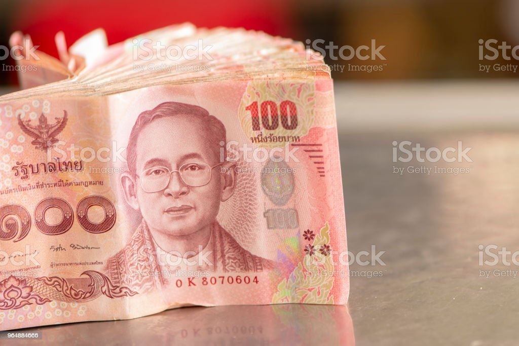 Thai Bath, pile of banknotes and coins royalty-free stock photo