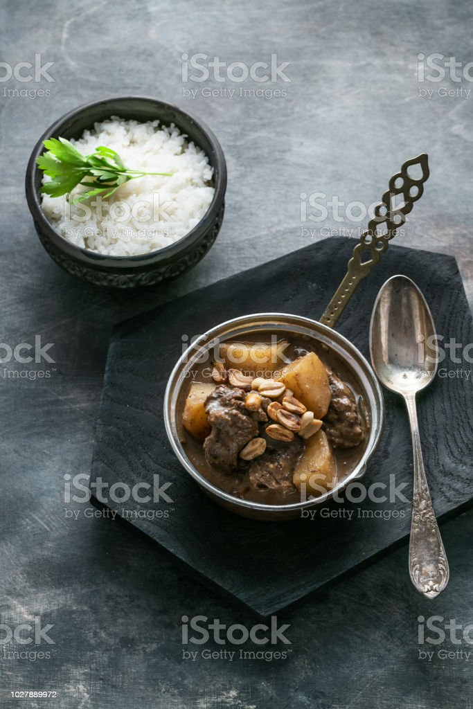 Thai Beef Massaman Curry with Rice, dark background copy space stock photo