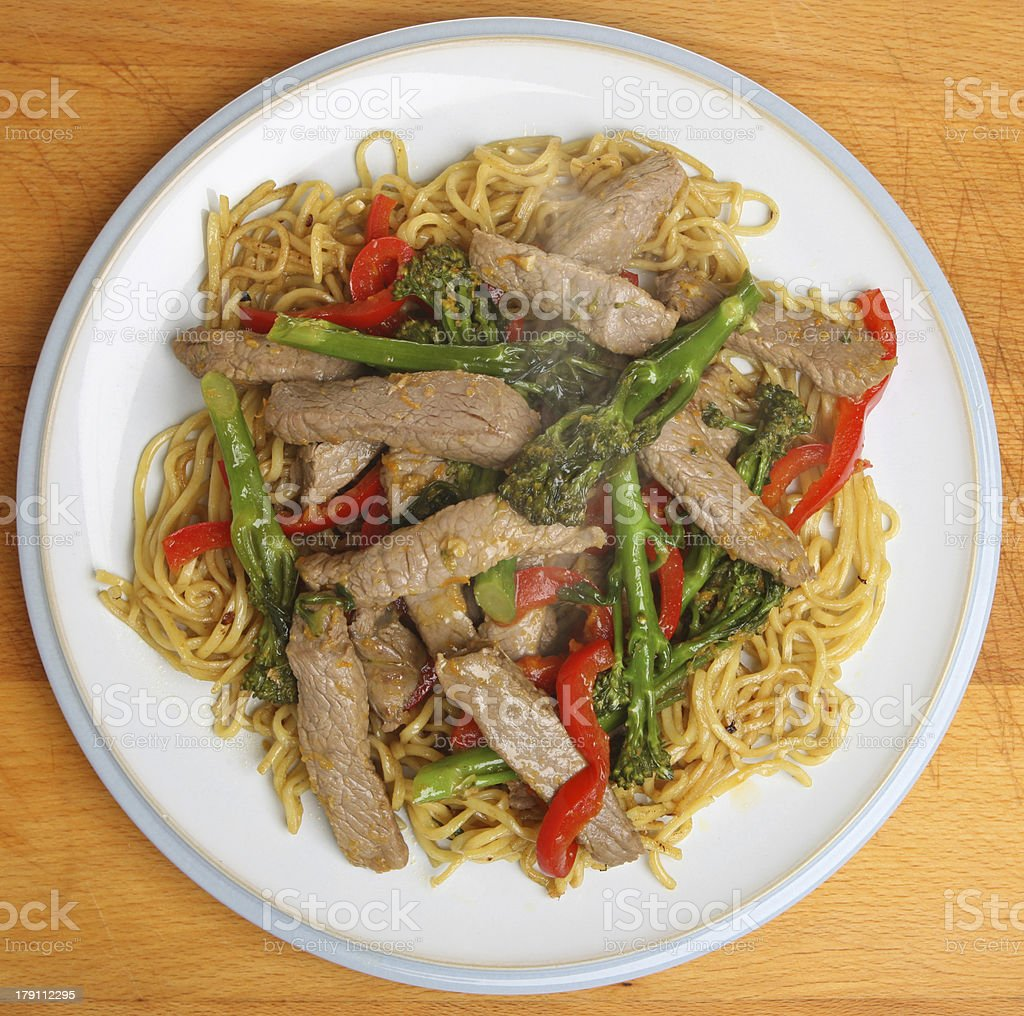 Thai Beef with Broccoli and Noodles stock photo