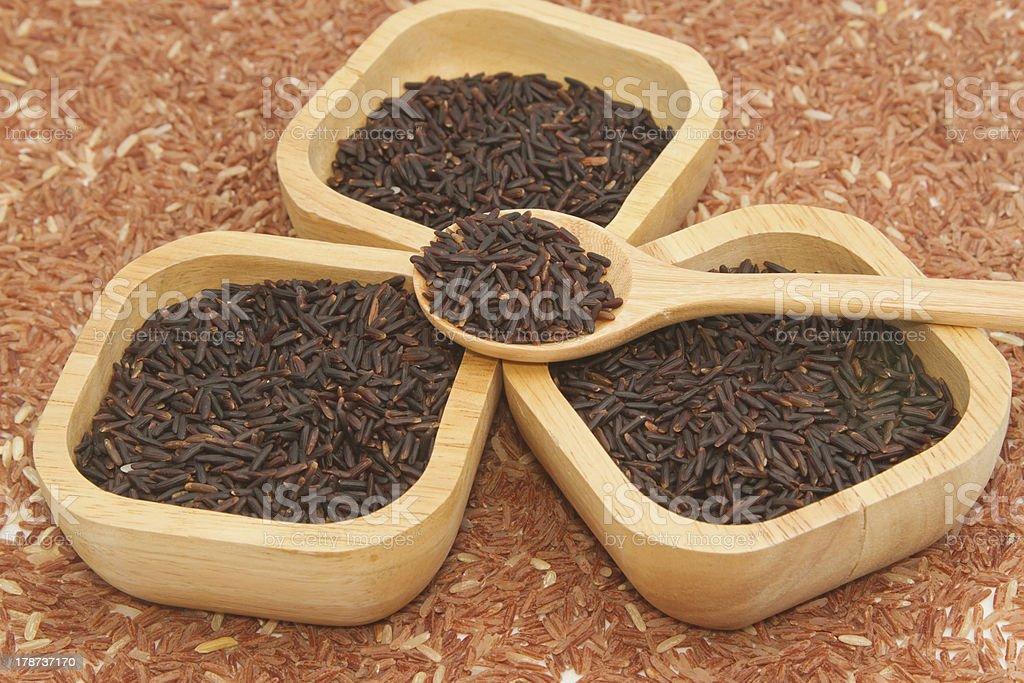 Thai black jasmine rice (Rice berry) in wooden bowl royalty-free stock photo