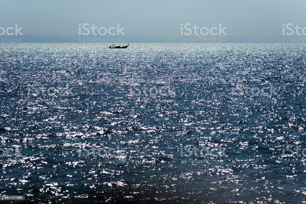 Thai boat on the horizon royalty-free stock photo