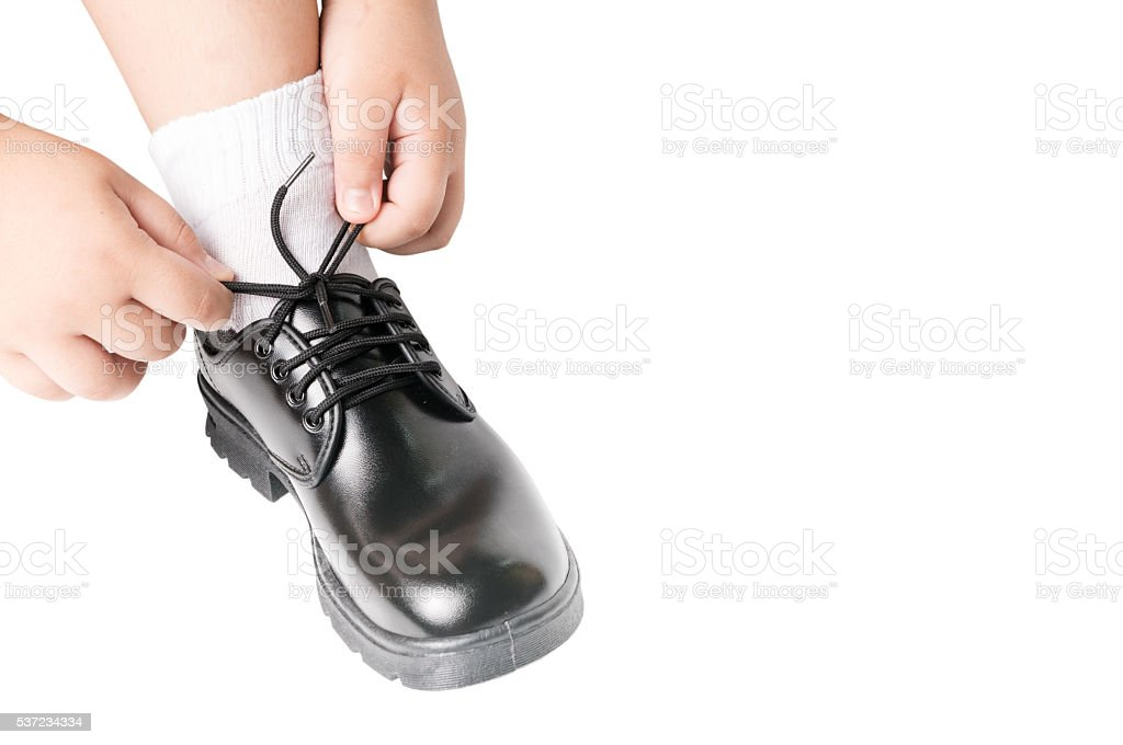 Thai boy is tying the laces student shoe stock photo