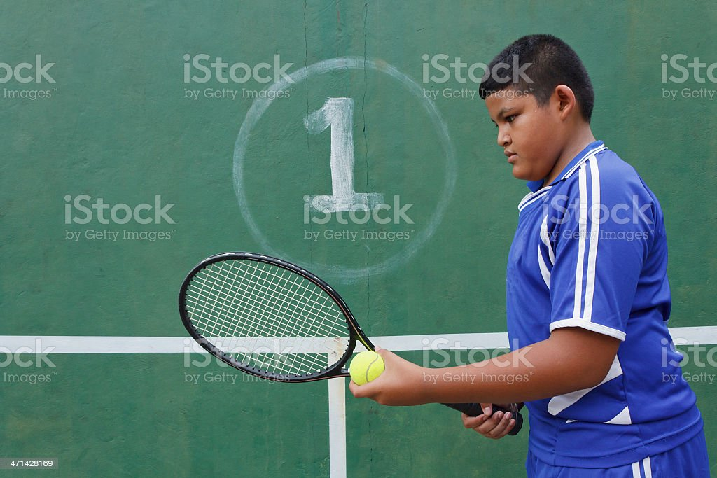Thai boy tennis player royalty-free stock photo