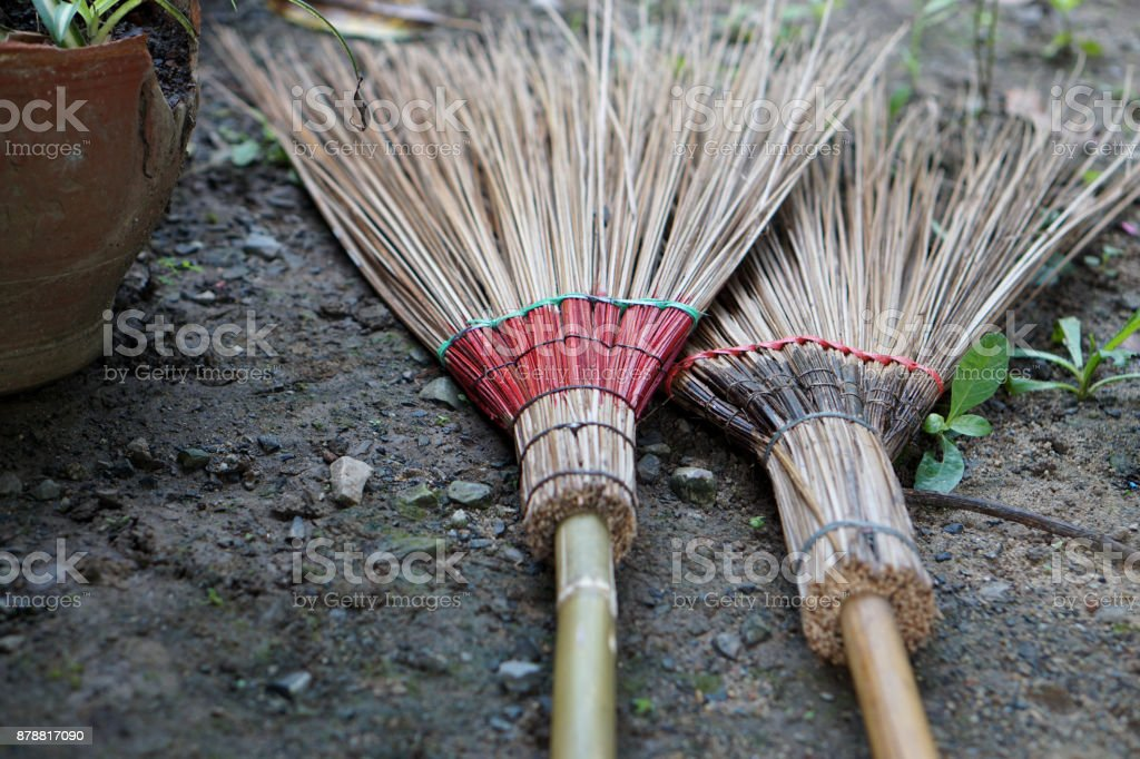 Thai brooms lying on the floor stock photo