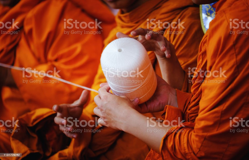 Thai buddhist monks Praying in Temple at Buddhist temple holding...