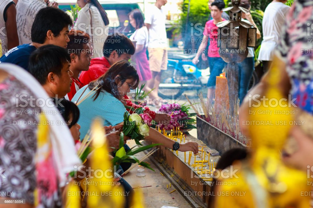 Thai Buddhist People Pray Buddha State With Water Lily