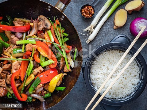 Thai stir fried chicken with vegetables and lemon grass, served with jasmine rice on the side.