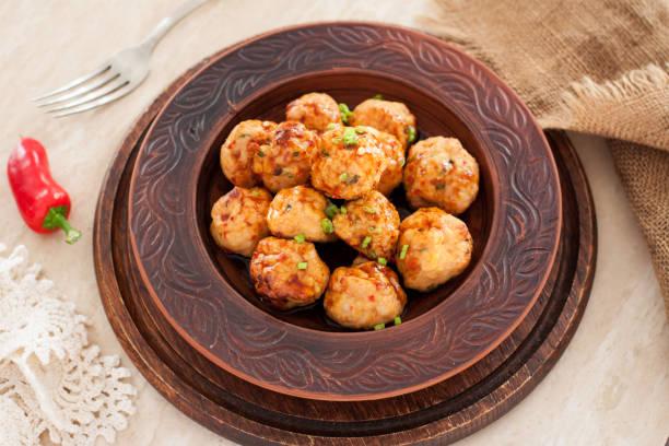 Thai chili chicken meatballs with sauce stock photo