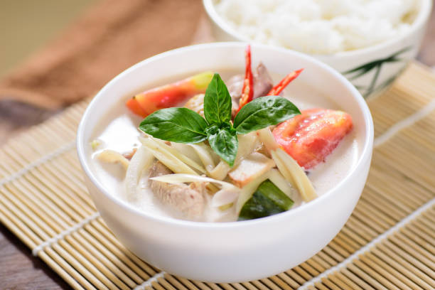 Thai coconut milk soup with chicken stock photo
