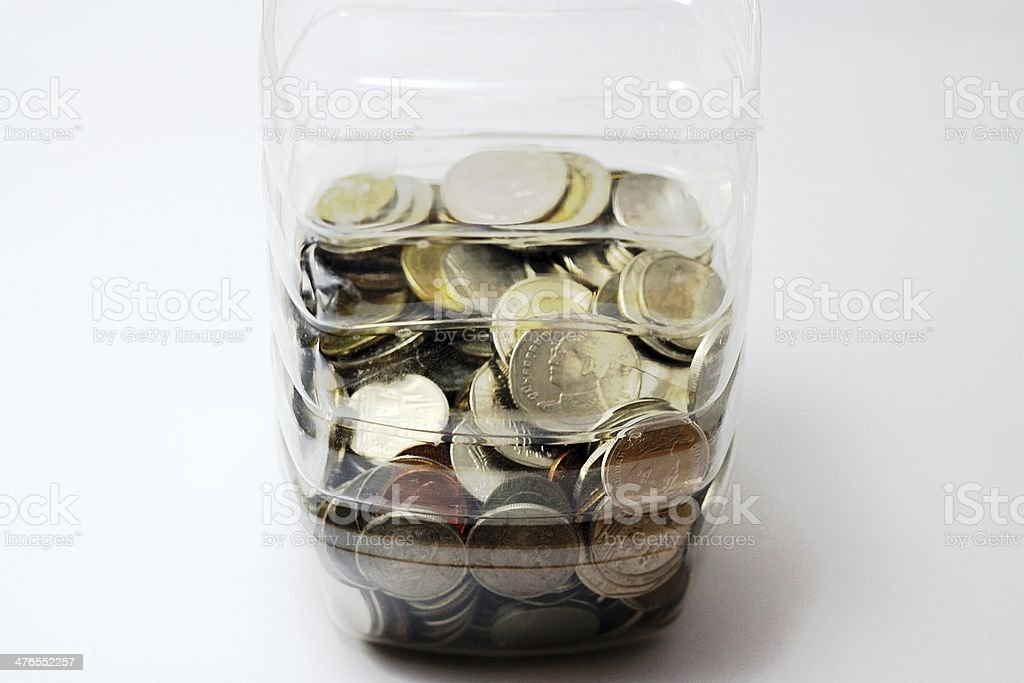 Thai coins in a bottle. royalty-free stock photo