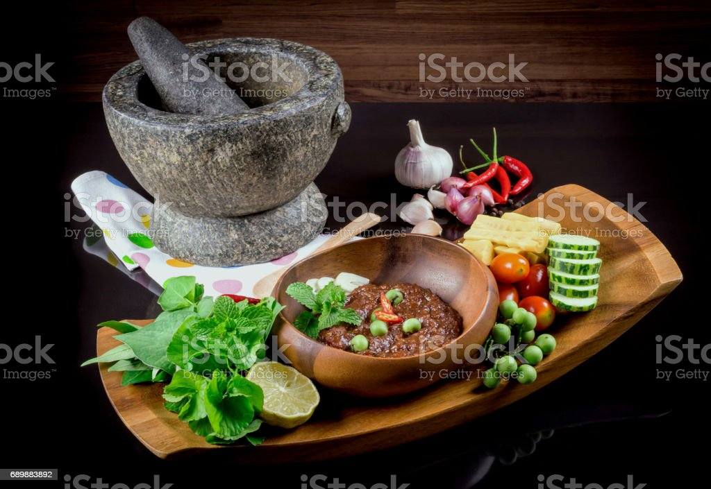 Thai cuisine nam prik or chili paste mixes with fish serves with various vegetables stock photo